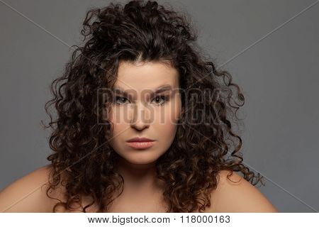 Pretty young girl is evincing serious emotions
