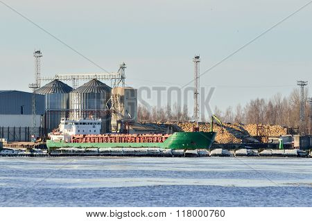 Green Cargo Ship Loading In Industrial Port