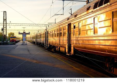 Trains At The Station At The Sunrise