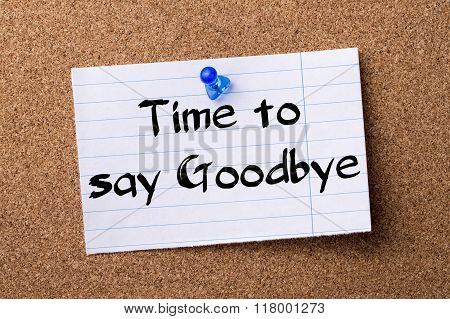 Time To Say Goodbye - Teared Note Paper  Pinned On Bulletin Board
