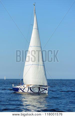 White Sail Yacht Sailing In Sea. Riga, Latvia