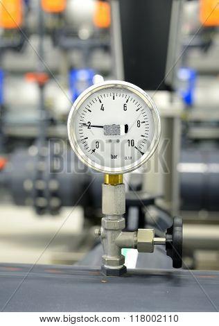 Industrial Barometer Dial On A Pipe In Boiler Room