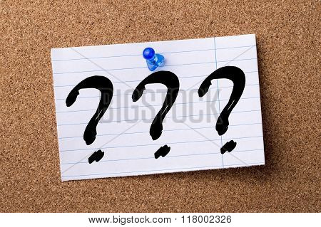 Three Question Marks - Teared Note Paper  Pinned On Bulletin Board