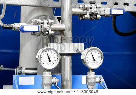 Metal pipes and equipment in an industrial boiler room interior