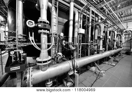 Industrial Boiler Room with pipes and other equipment