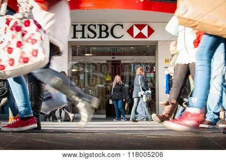 People walk past a HSBC bank branch in Liverpool