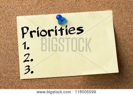 Priorities 1. 2. 3. - Adhesive Label Pinned On Bulletin Board