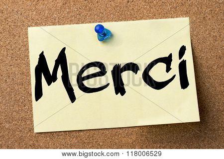Merci - Adhesive Label Pinned On Bulletin Board
