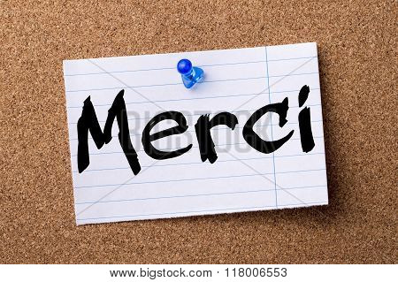 Merci - Teared Note Paper  Pinned On Bulletin Board