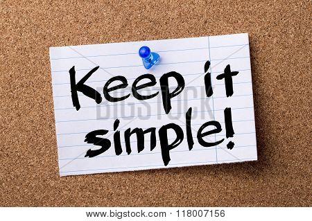 Keep It Simple! - Teared Note Paper  Pinned On Bulletin Board