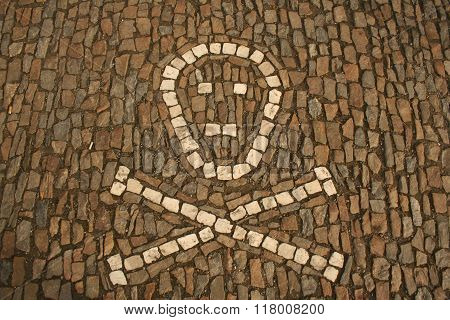 Symbol Of Crossed Bones And Skull Created From White Cobbles On The Ground. Taken In Sedlec, Kutna H