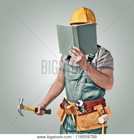 construction worker with a tool belt and book