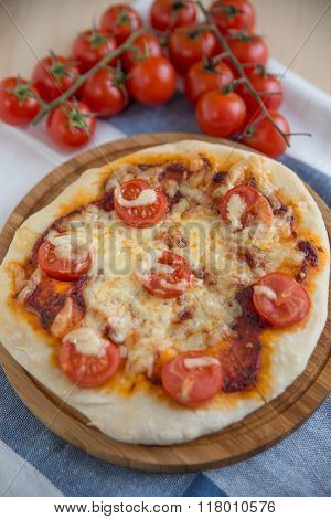 Home made Pizza with salami, cheese and tomatoes