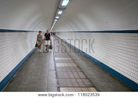 Pedestrians Passing A Hiking Tunnel Under River Schelde At Antwerp, Belgium