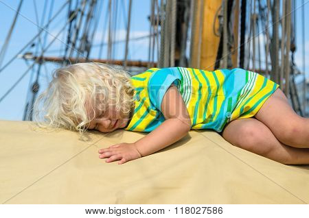 Little Girl Fell Asleep On The Deck Of A Sailboat