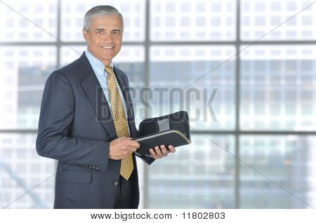 Standing Businessman With Planner Notebook