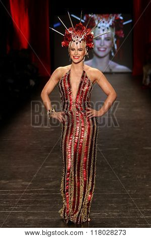 NEW YORK-FEB 11: Gigi Gorgeous wears Laurel DeWitt at Go Red for Women Red Dress Collection 2016 Presented by Macy's at New York Fashion Week at Moynihan Station on February 11, 2016 in New York City.
