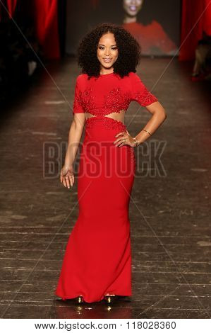 NEW YORK-FEB 11: Actress Serayah wears Reem Acra at Go Red for Women Red Dress Collection 2016 Presented by Macy's at New York Fashion Week at Moynihan Station on February 11, 2016 in New York City.
