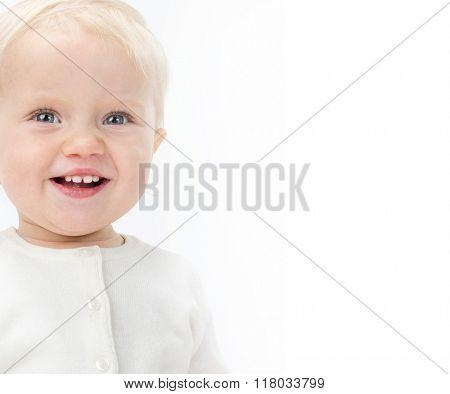little child baby smiling portrait warm clothing isolated on white studio shot