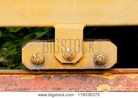 Yellow Steel wheel old Rust door for background