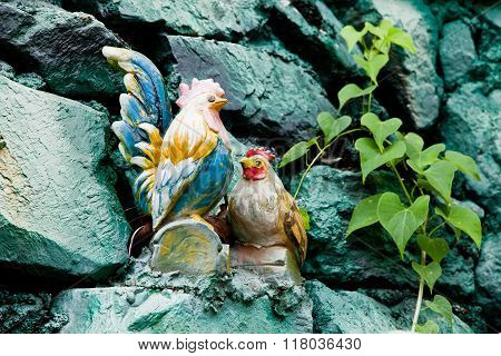 Ceramic Hen and Rooster on stone for decorate