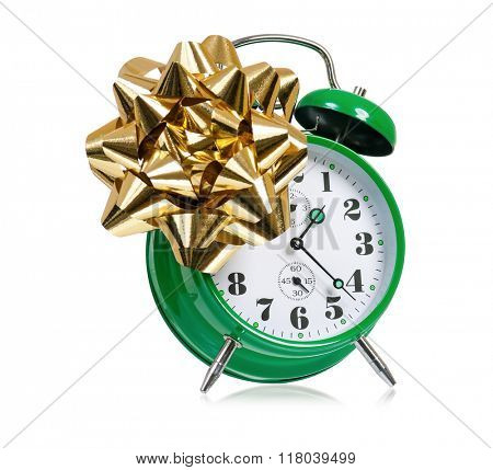Big green alarm clock with bow, isolated on white background