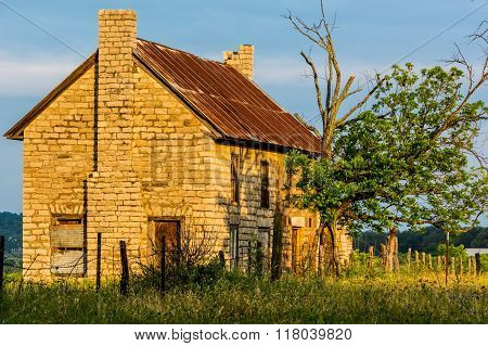 An Old Abandonded Texas Farmhouse With Various Wildflowers