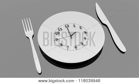 Fork, knife and plate with clock dial , isolated on black background.