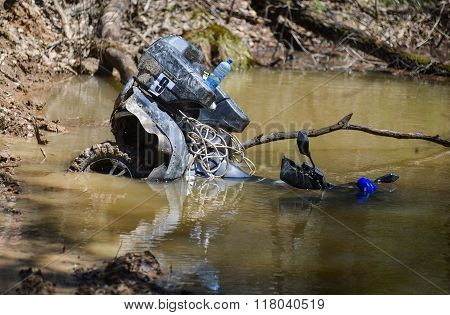 ATV drowned in a large puddle
