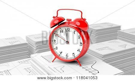 Red alarm cloack on stack of paperwork with graphs, isolated on white background.