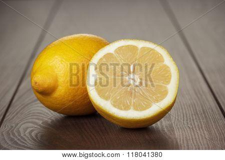 fresh lemons on the wooden table
