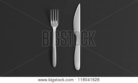 Fork and knife, isolated on black background.
