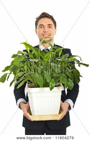 Business Man Holding A Big Vase With Plant