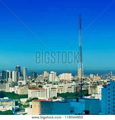 Communications Tower in the city and blue sky
