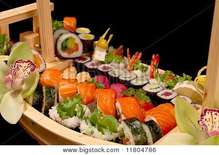 close-up of wooden boat with sushi