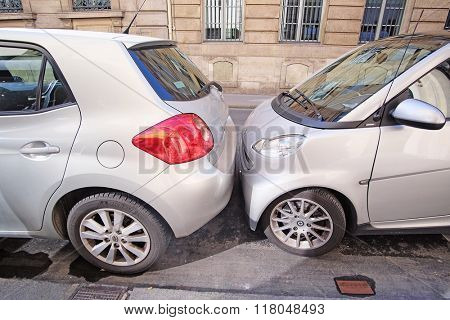 Paris, France, February 9, 2016: cars on a parking in Paris, France. In Paris it is normal to park the cars