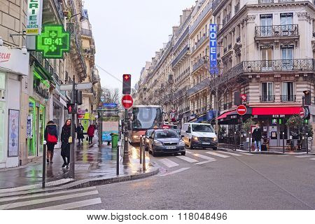 Paris, France, February 9, 2016: pedestrian cross in a center of Paris, France