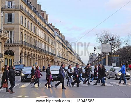Paris, France, February 9, 2016: pedestrian cross road in a center of Paris, France