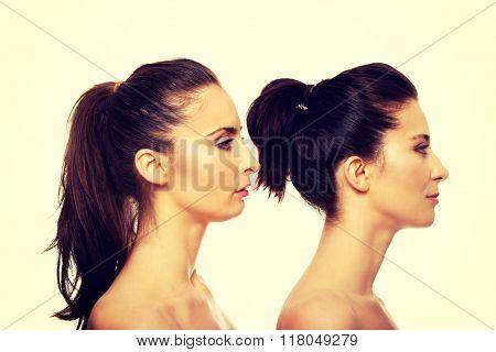 Beauty woman standing behind her friend.