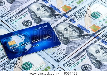 Blue Worldwide Credit Card On American Dollars Background