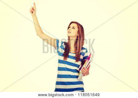 Teenage woman showing copyspace or something
