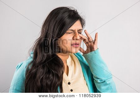 indian girl with headache, asian girl with headache, indian woman with headache holding her hand to