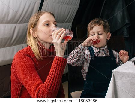 Mother And Child Drinking