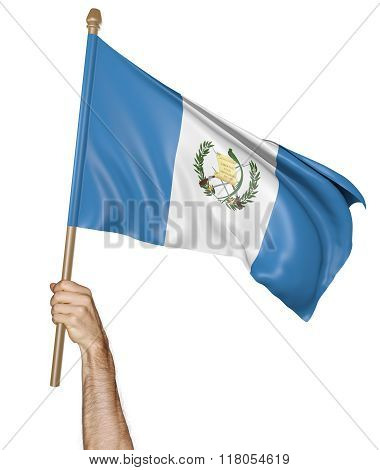 Hand proudly waving the national flag of Guatemala