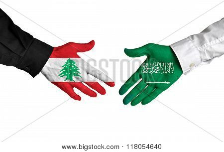 Lebanon and Saudi Arabia leaders shaking hands on a deal agreement
