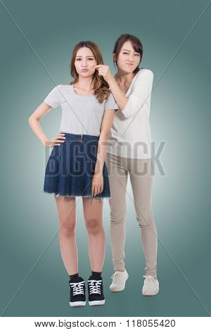 Asian woman with her friend, studio shot portrait.