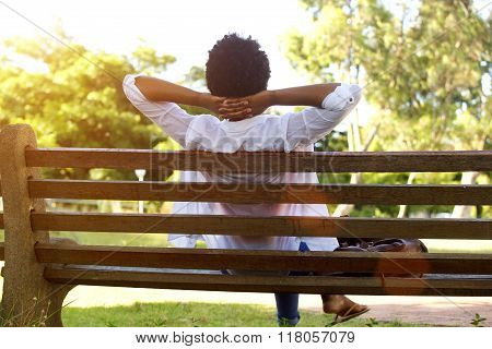 Young Lady Sitting Relaxed On A Park Bench