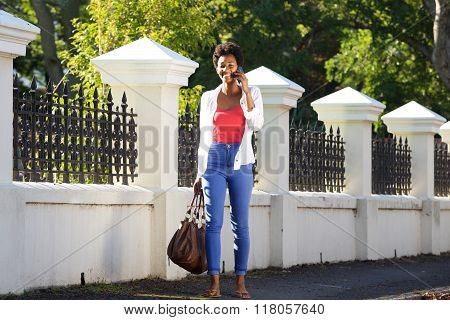 African Woman Walking And Talking On Mobile Phone