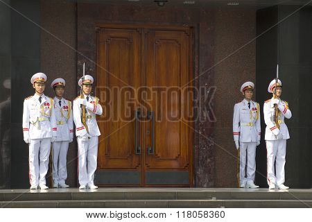 Changing of the guard at the door of the Ho Chi Minh mausoleum. Hanoi, Vietnam