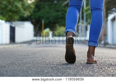 Female Legs Walking On The Road